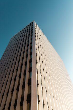 white-concrete-building-under-blue-sky-3795236